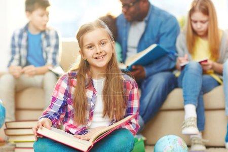 schoolgirl with open book