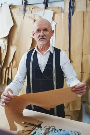 tailor working with patterns