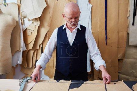 tailor measuring paper patterns