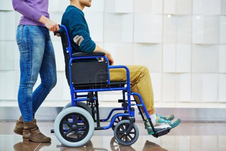 man in wheelchair with caregiver