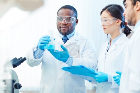 Photo for Group of modern chemists with new substance in lab - Royalty Free Image
