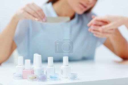 Manicurist doing nails