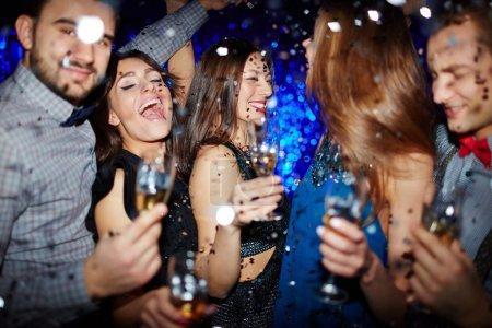 Photo for Young happy people dancing with champagne at party - Royalty Free Image