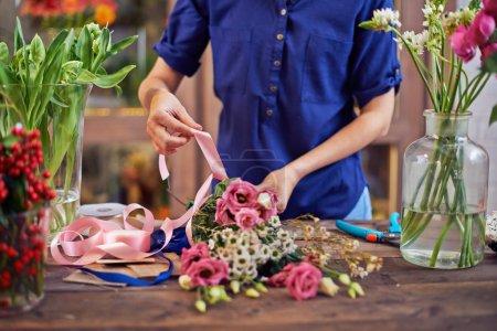 hands arranging bouquet