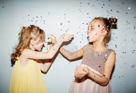 girls playing with cake