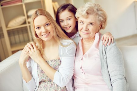 Photo for Little girl, young and senior women looking at camera with smiles - Royalty Free Image