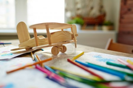 Wooden airplane, pencils