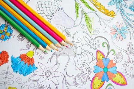 pencils on coloring book