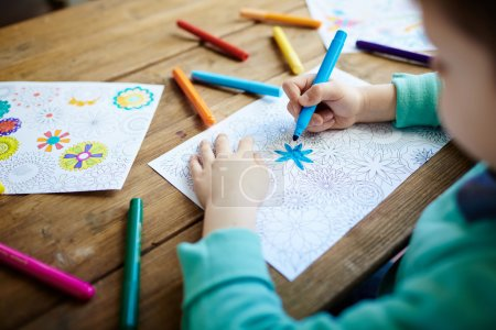 Child coloring flowers