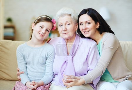Photo for Portrait of three female generations looking at camera - Royalty Free Image