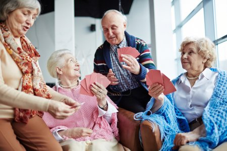 Photo for Group of friendly seniors playing cards at leisure - Royalty Free Image