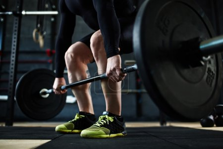 man training with barbell