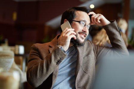 businessman speaking on cellphone