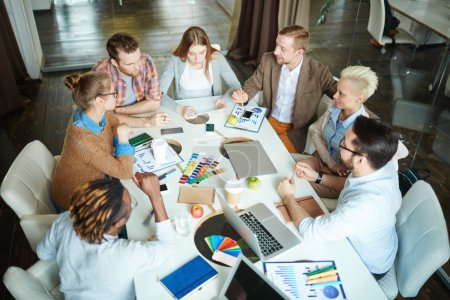 Photo for Team of colleagues communicating at meeting in office - Royalty Free Image