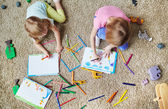 girls drawing together