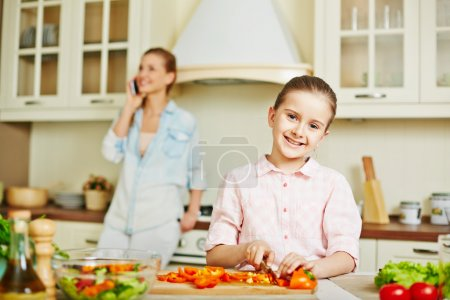 Girl cutting vegetables
