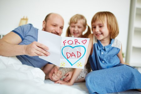 Father reading card