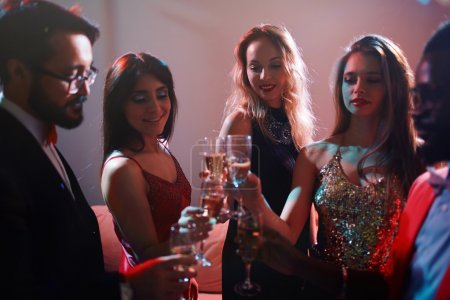Photo for Young happy people dancing and toasting with champagne at party - Royalty Free Image