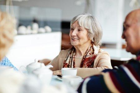 seniors talking by tea