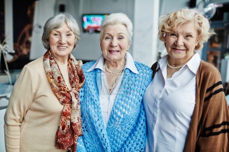 Photo for Portrait of three senior women smiling at camera - Royalty Free Image