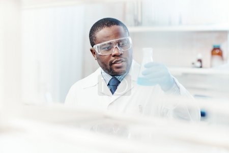 Photo for Modern chemist with new substance in lab - Royalty Free Image