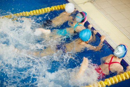 children training in pool