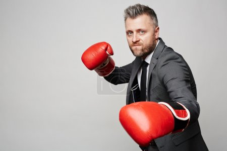 business leader in boxing gloves