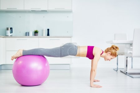 girl exercising with fit-ball