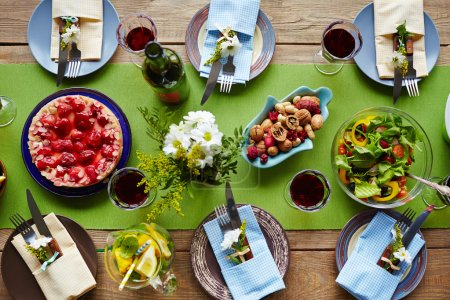 Photo for Festive table setting served for dinner of homemade food - Royalty Free Image