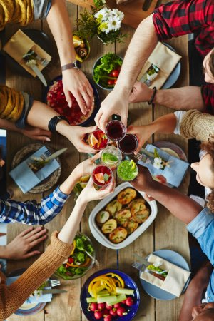 Photo for Group of friends toasting with red wine during dinner - Royalty Free Image