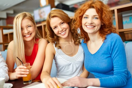 Photo for Three happy girls relaxing in cafe - Royalty Free Image