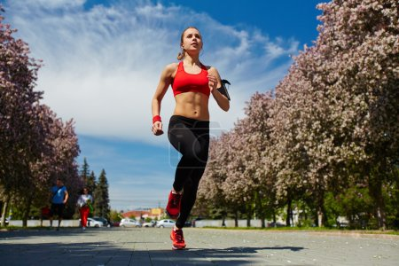 Pretty runner jogging outdoors