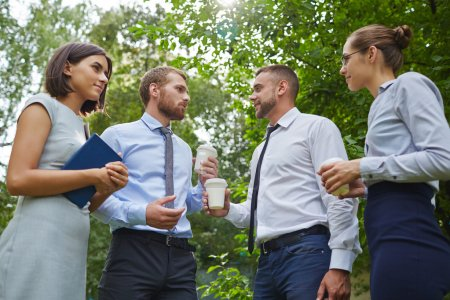 Successful employees having discussion