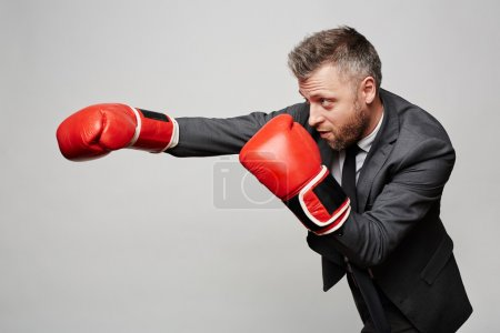 Successful businessman in boxing gloves