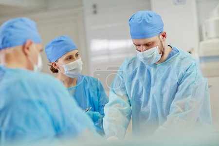 Group of surgeons during operation