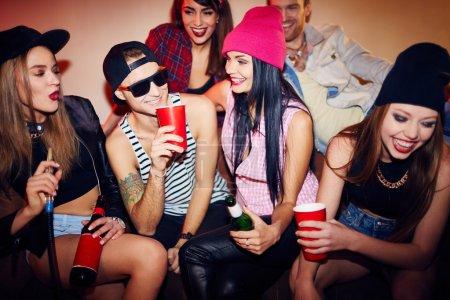 Photo for Group of friends having fun at swag home party - Royalty Free Image