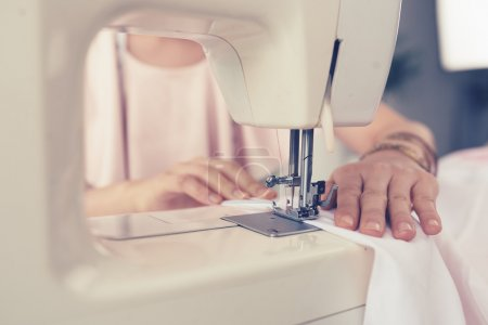 Woman's hands sewing