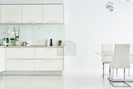 Photo for Interior of modern kitchen with cupboards, table and chairs - Royalty Free Image