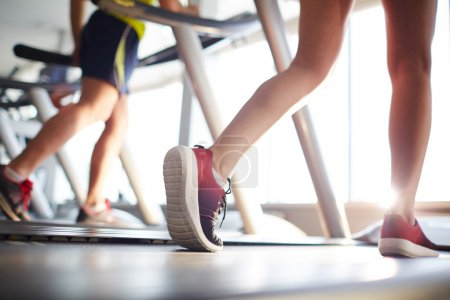 Photo for Active people running on treadmills in gym - Royalty Free Image