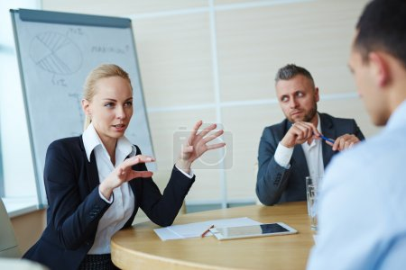 Businesswoman explaining her ideas at meeting