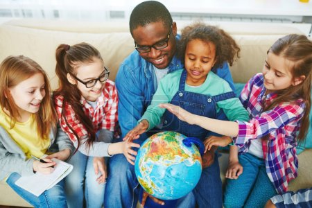 Teacher learning the planet with children
