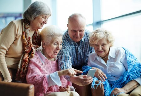 Photo for Group of modern seniors with smartphone making selfie - Royalty Free Image