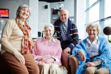 Photo for Group of happy seniors relaxing in cafe - Royalty Free Image