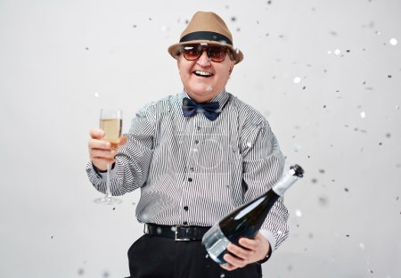Laughing man toasting