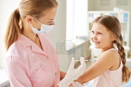 Nurse making girl injection