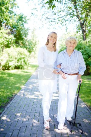 Pretty nurse and senior patient