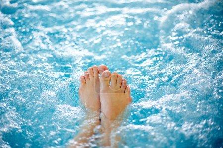 Female legs in hot tub