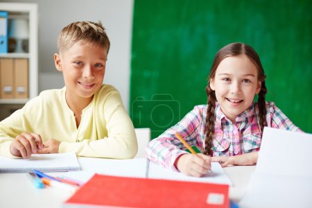 Photo for Portrait of happy classmates looking at camera at lesson of drawing - Royalty Free Image