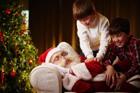 Boys trying to wake Santa up