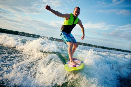 Young man surfboarding